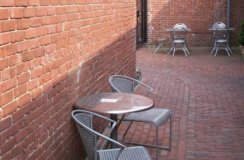 How to clean a brick patio?