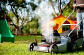 Why is my lawn mower blowing white smoke?