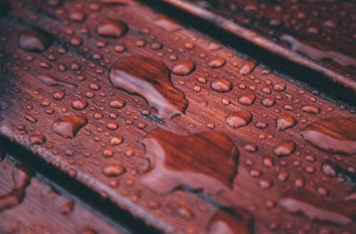 How long after staining a deck can it rain?